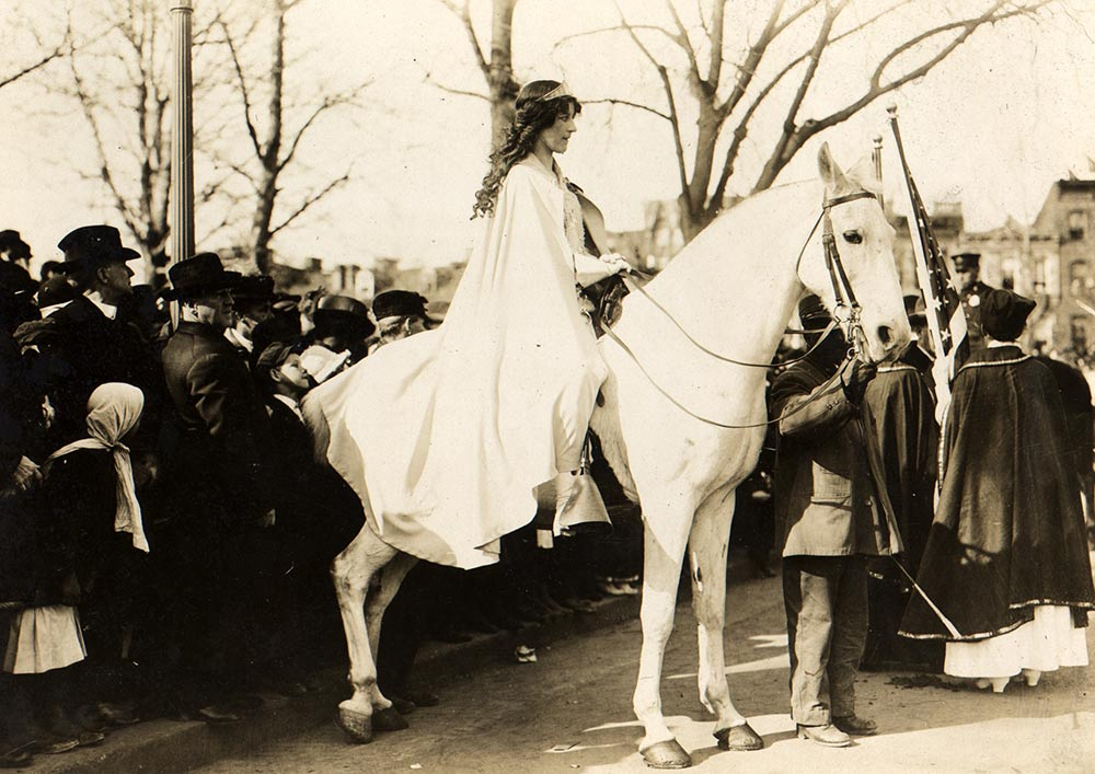 Inez Milholland seated on white horse at the National American Woman Suffrage Association parade, Washington DC, March 3, 1913 (Library of Congress)