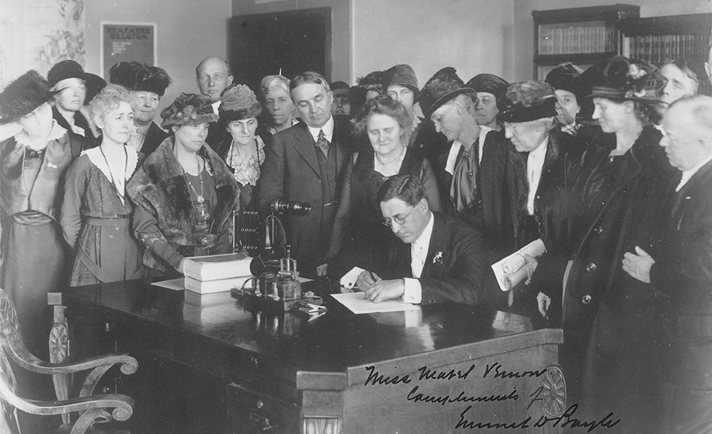 Governor Emmett D. Boyle of Nevada signing the resolution for ratification of the Nineteenth Amendment surrounded by a group of suffragist women, Carson City, Nevada, February 7, 1920. (Prints and Photographs Division, Library of Congress)