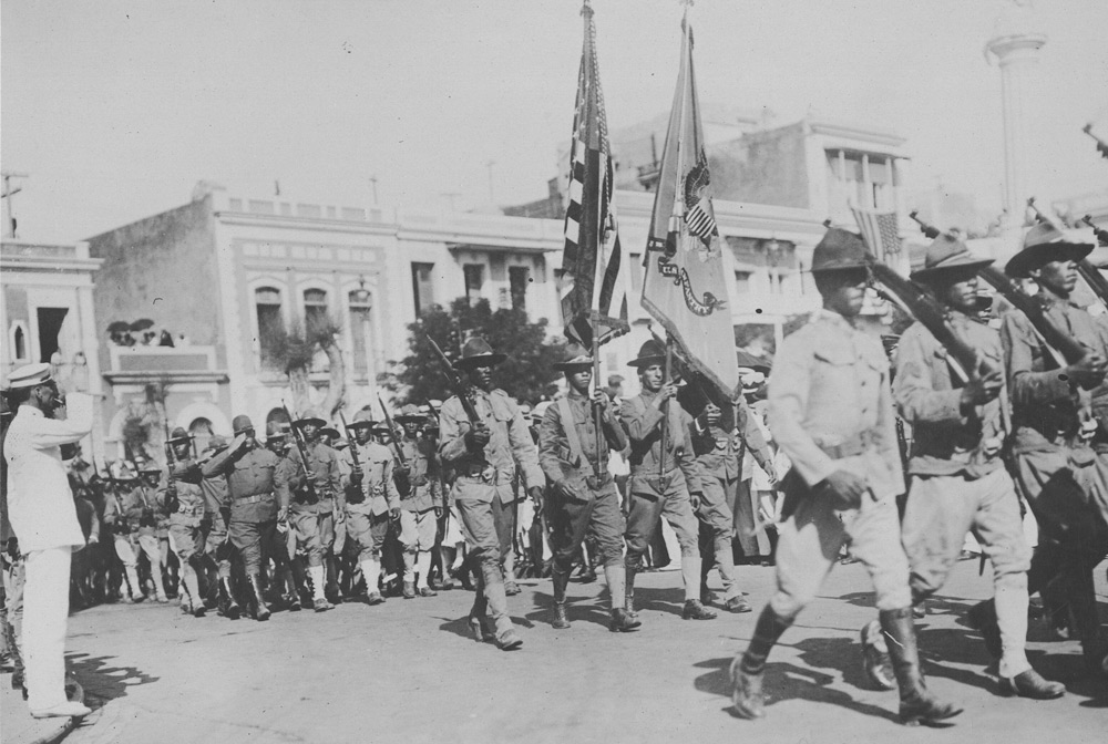 Puerto Rican soldiers of the 375th Regt. Inf. passing before the grand stand in the Liberty Day demonstration in Puerto Rico, October 1918 (National Archives)
