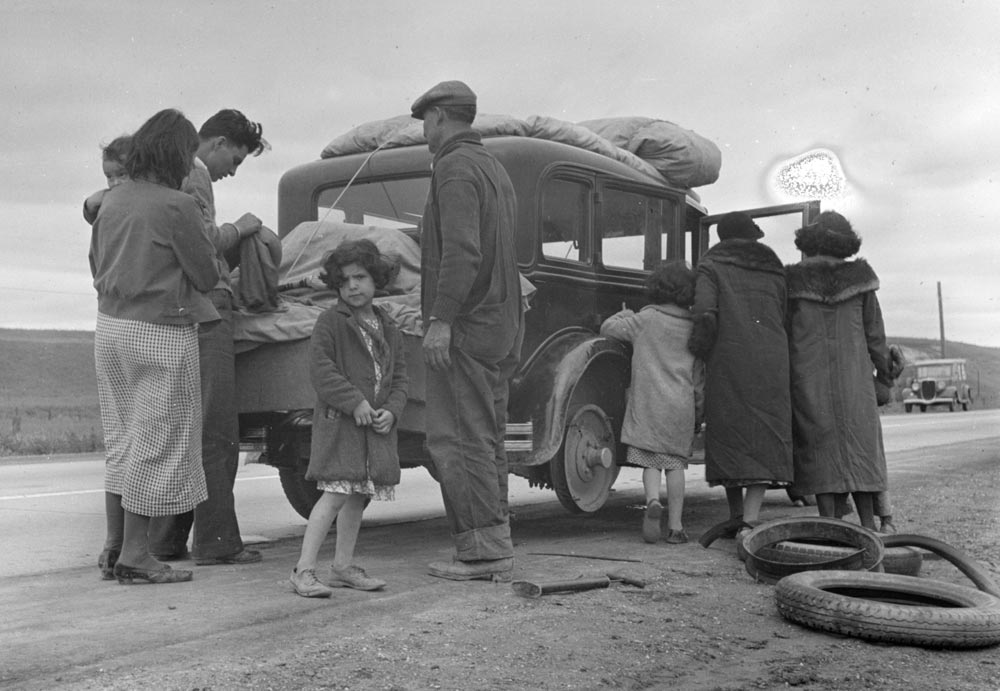 """Migrants, family of Mexicans, on road with tire trouble,"" photograph by Dorothea Lange, February 1936 (Library of Congress)"