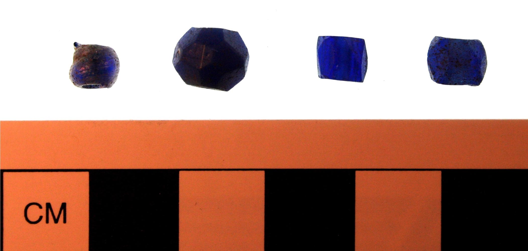 Blue glass trade beads, recovered from Cabin W-12. Many historical archaeologists have interpreted these types of beads, especially cobalt blue examples, as potential charms, worn by enslaved people to ward off malevolent forces. (Courtesy of James M. Davidson)