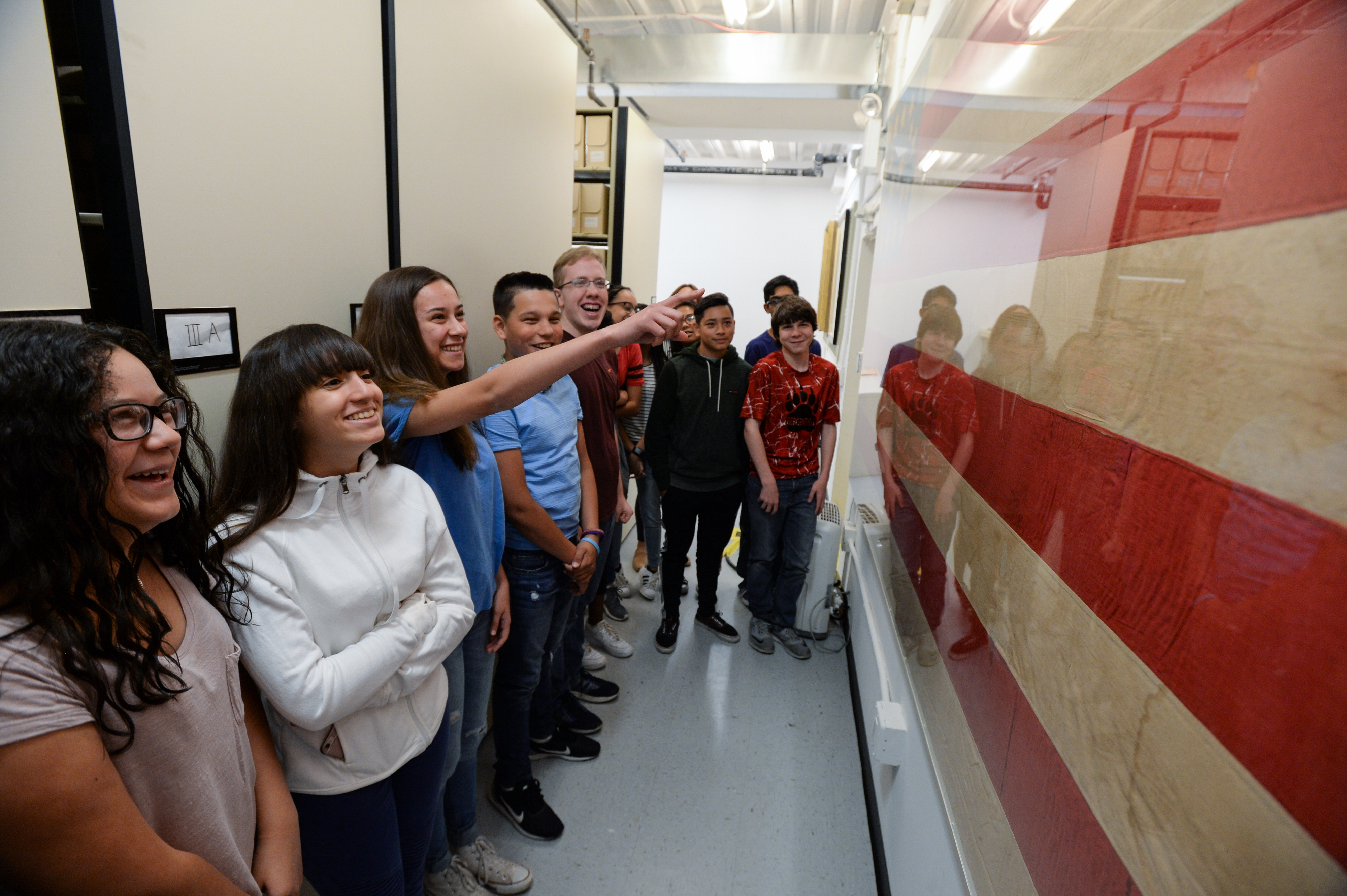 Students from Roy Brown Middle School in Bergenfield, New Jersey, examining a unique abolitionist flag in the Gilder Lehrman Collection