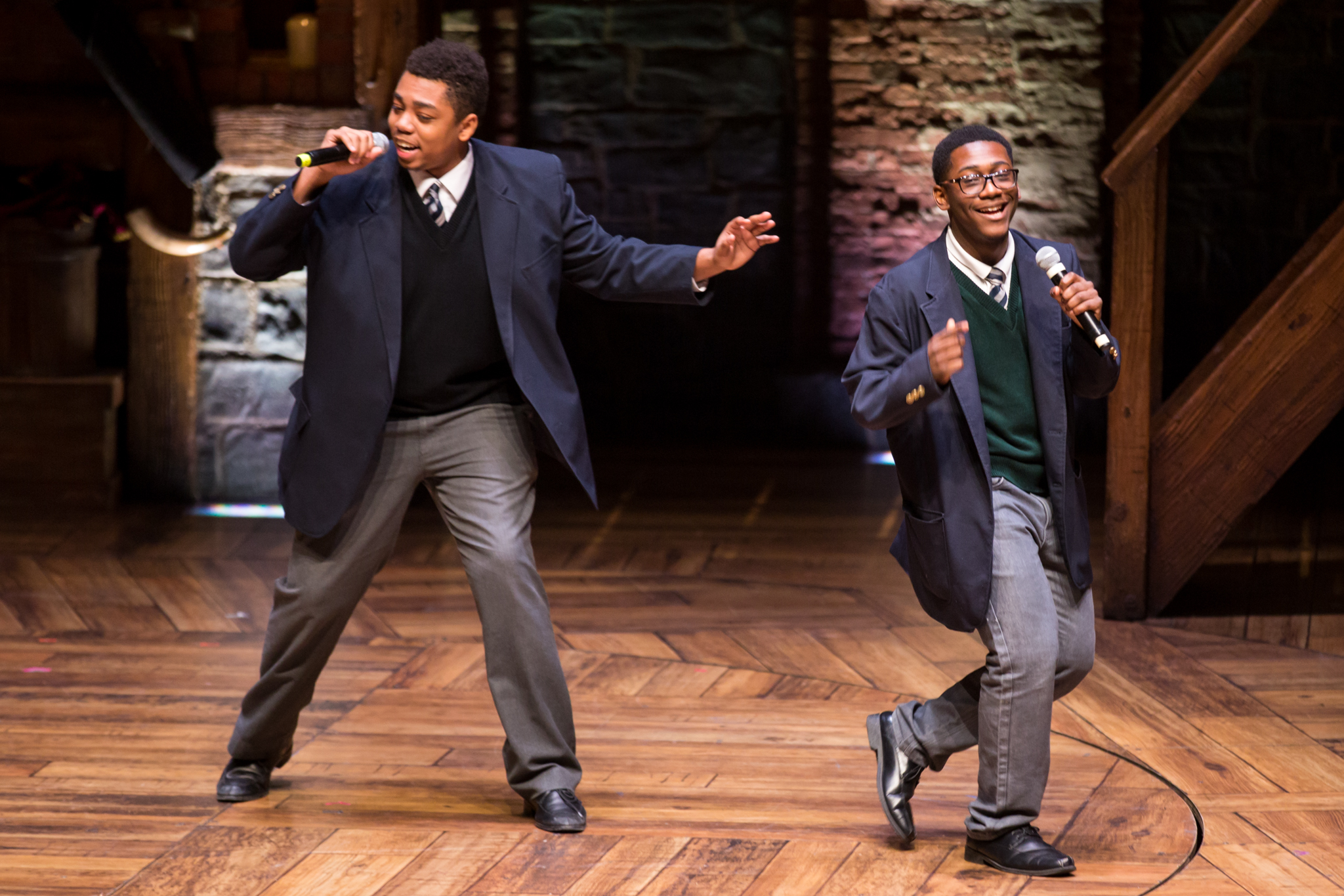 Students Marcus Bornelus and Kendrick Jones performing on stage during a HEP student matinee in Chicago on 02/ 22/17