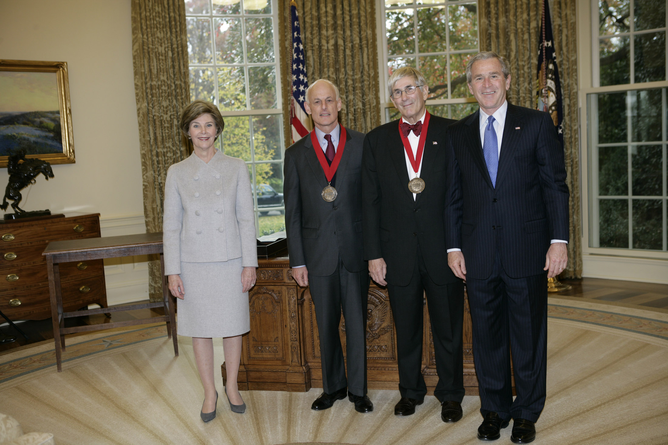 Lewis Lehrman and Richard Gilder receive the 2005 National Humanities Medal at the Whitehouse with President George W. Bush and First Lady Laura Bush