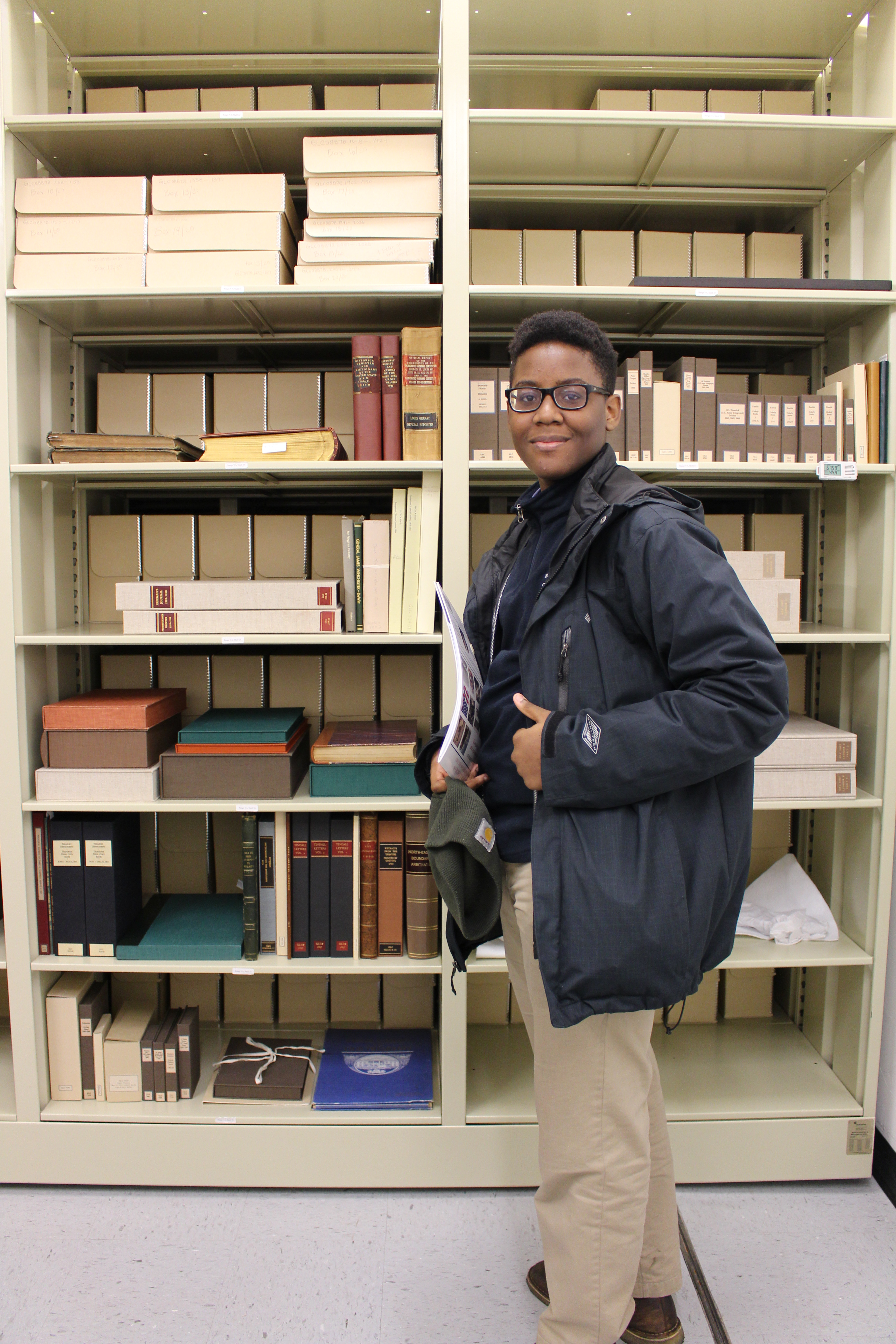 A Brooklyn Collegiate student in the vault at the Gilder Lehrman Collection.