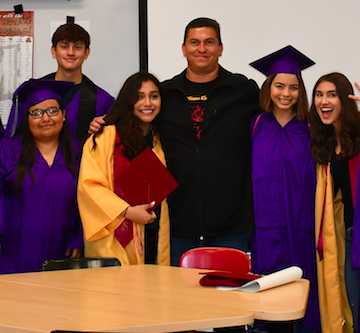 2020 National History Teacher of the Year Sergio de Alba with graduating students