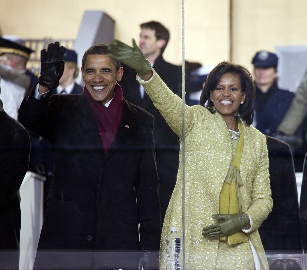 Inaugural Parade. Michelle and Barack Obama watch the parade from the viewi