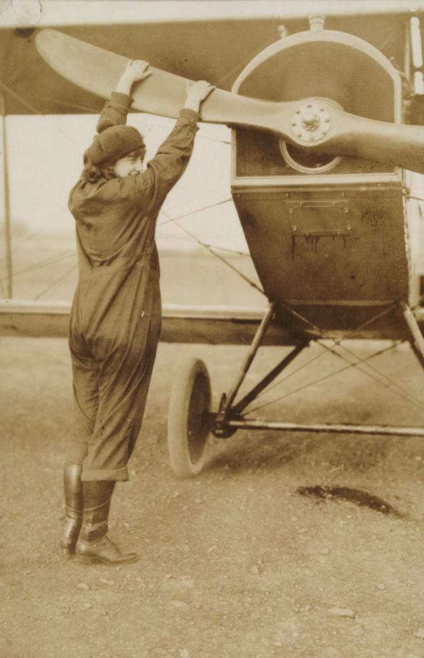 Neta Snook with plane, ca. 1920 (GLC07243.006.03)