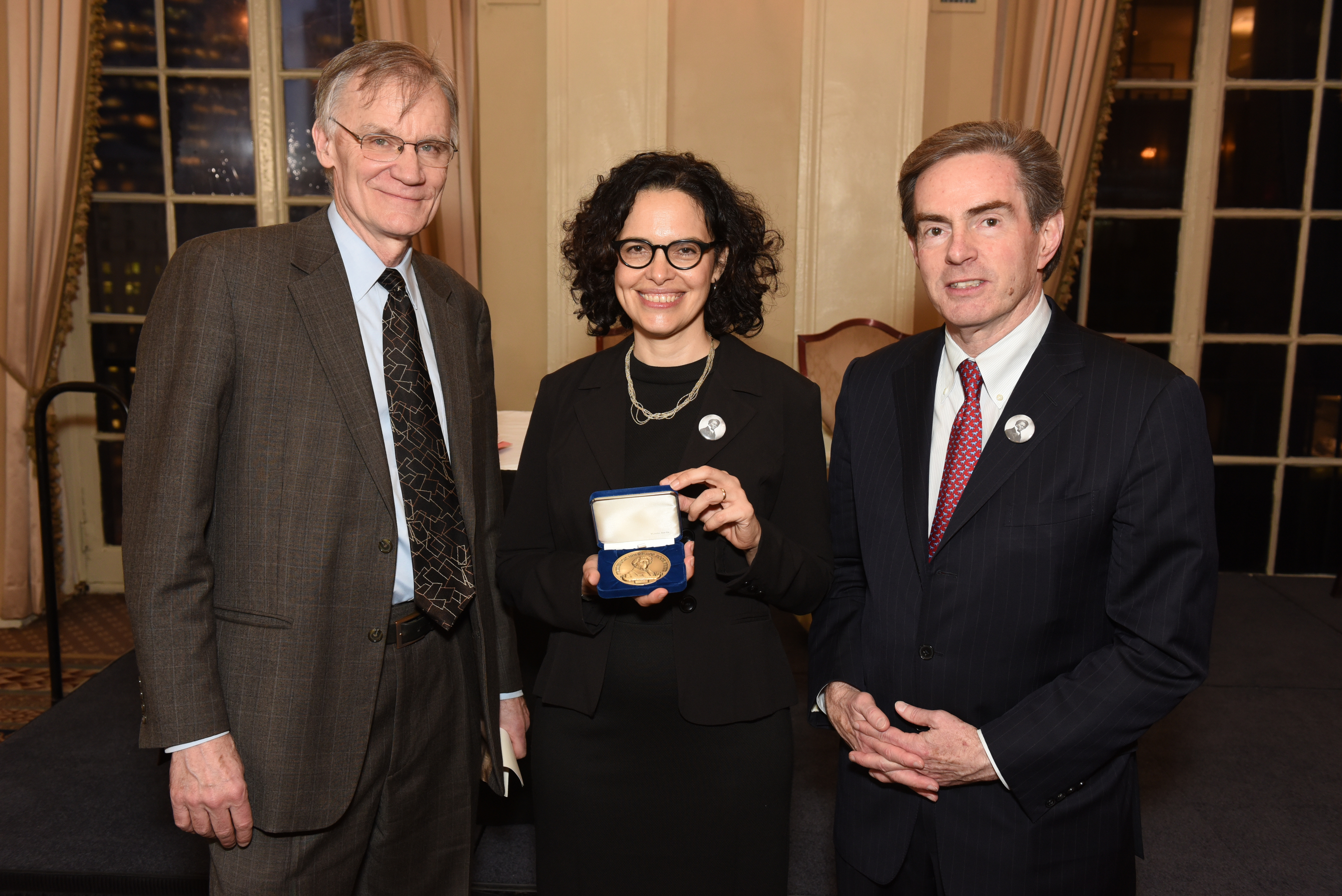 Ada Ferrer holds her award alongside Gilder Lehrman President James Basker and D