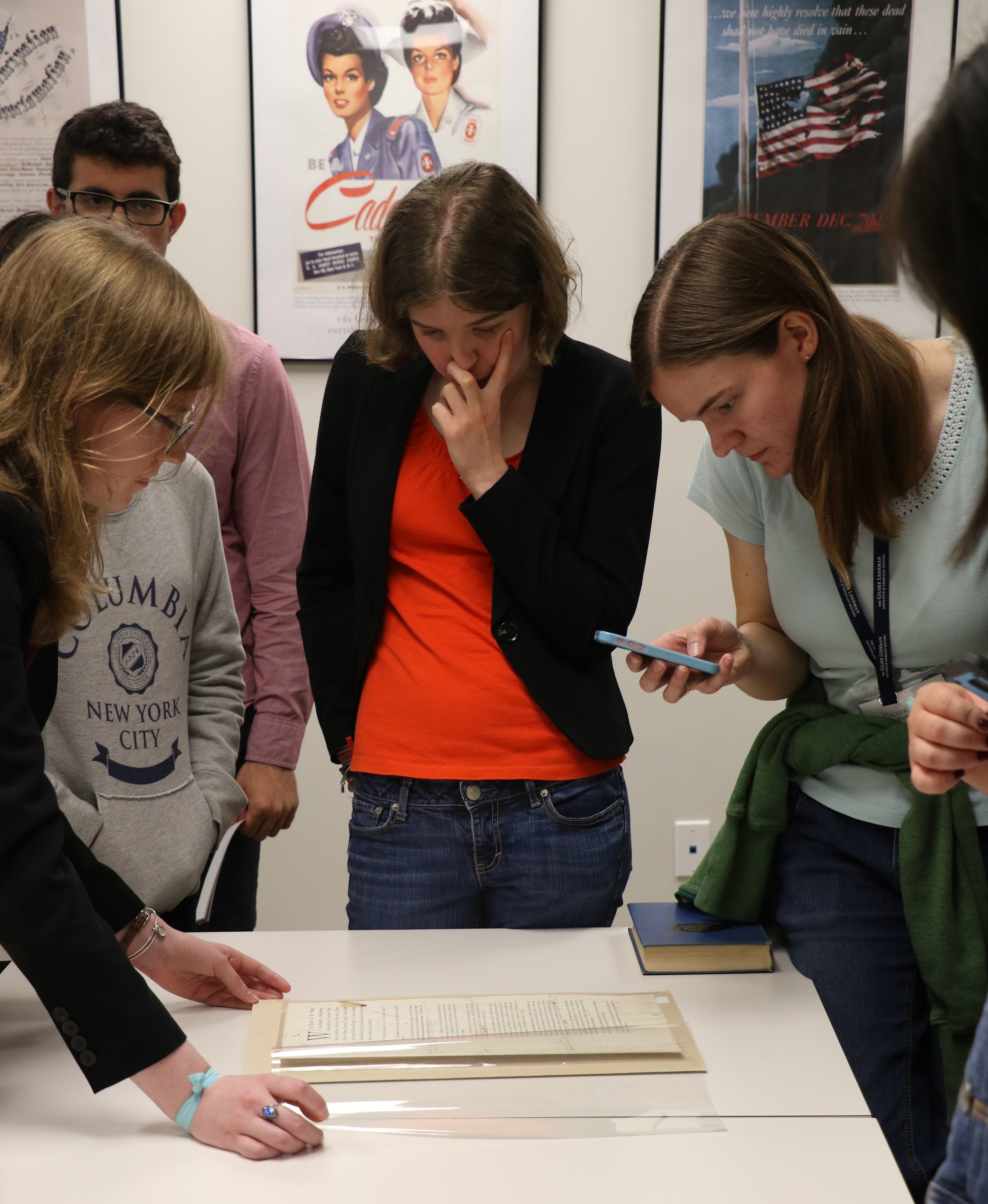 Melanie Sheehan (center) gets a close look at the first draft of the US Constitution at the Gilder Lehrman Collection.