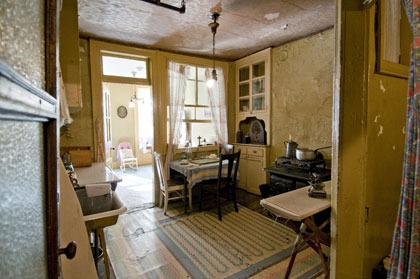The kitchen and parlor of the restored Baldizzi apartment at 97 Orchard Street.