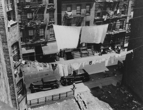 Street seen through a clothesline, c. 1935-37. (Photograph by Arnold Eagle, Coll