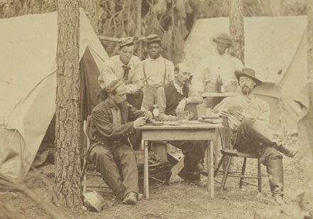 Men and officers of the 114th Pennsylvania enjoy a card game in August 1865. The