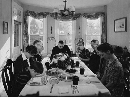 Saying grace before Thanksgiving dinner in Neffsville, Pennsylvania (1942)
