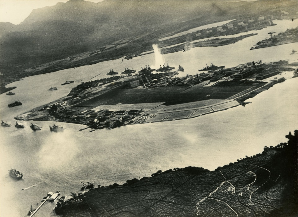 Photograph taken from a Japanese plane during the torpedo attack on ships moored on both sides of Ford Island.  (The Gilder Lehrman Institute of American History, GLC09552.03)