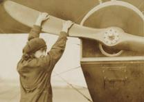 Neta Snook with plane, ca. 1920 (GLC07243.006.03)