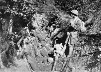 American soldiers rest in a trench in the Argonne Forest, France, 1918. From Col