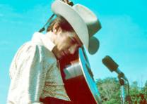 Corwin, Robert, photographer. Phil Ochs, Newport Folk Festival, 1966. Photograph