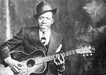 Robert Johnson, portrait by Hooks Bros., Memphis, TN, ca. 1935. (Wikipedia)