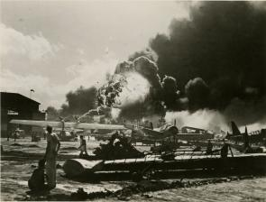 Servicemen observe the bombing of military airfields in Hawaii, December 7, 1941. (Gilder Lehrman Collection)