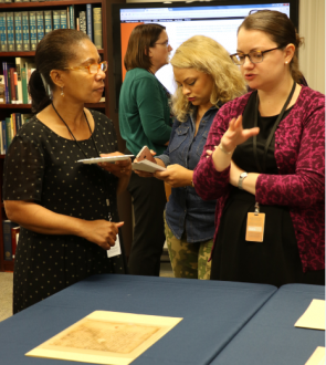 Curator Beth Huffer chats with teachers about historic documents.