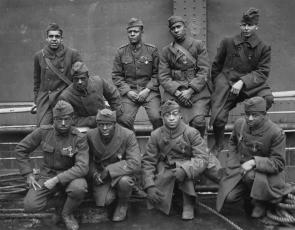 Soldiers of the 369th who won the Croix de Guerre, 1919. Front row: Pvt. Ed Williams, Herbert Taylor, Pvt. Leon Fraitor, Pvt. Ralph Hawkins. Back Row: Sgt. H. D. Prinas, Sgt. Dan Storms, Pvt. Joe Williams, Pvt. Alfred Hanley, and Cpl. T. W. Taylor. (National Archives)