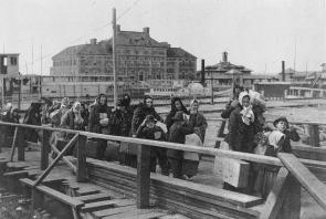 Landing at Ellis Island, ca. 1902 (LC-USZ62-12595)