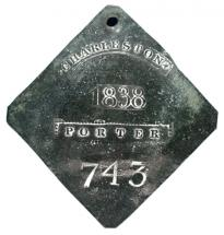 Metal slave tag for porter number 743, 1838 (Gilder Lehrman Collection)