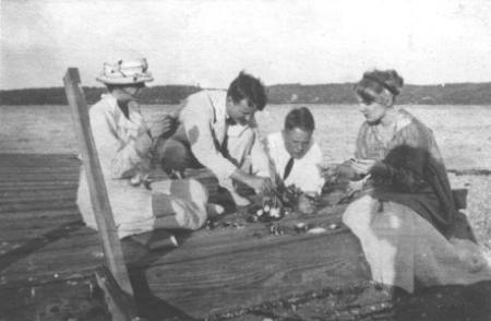 Eating Oysters at Roosevelt's beach on Cold Spring Harbor, c.1915. From left to