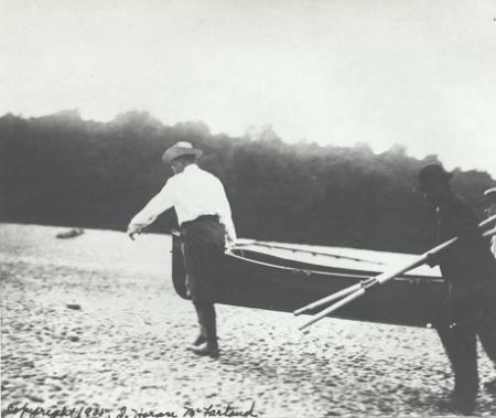 Theodore Roosevelt carrying a rowboat on his Cold Spring Harbor Beach with a Sag