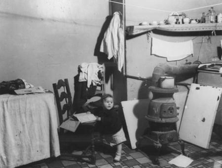 Unidentified child in a Lower East Side tenement, c. 1935-37. (Photograph by Arn