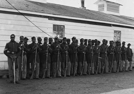 Here the men of Co. E, 4th United States Colored Infantry are photographed in th