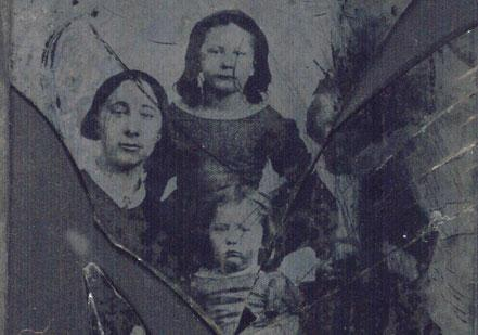 Elizabeth Tillotson with Georgiana (standing) and Lucy in 1862. Son Leon is on t