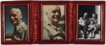 Red leather case with three photographs.