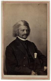 Half length seated carte de visite portrait of Frederick Douglass, with cane