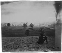 Antietam battlefield, with Federal soldier surveying the field with binoculars from atop a hill, near McClellan's headquarters.