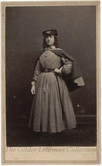 Vivandiere woman wearing infantry hat and long dress, standing full-length portrait